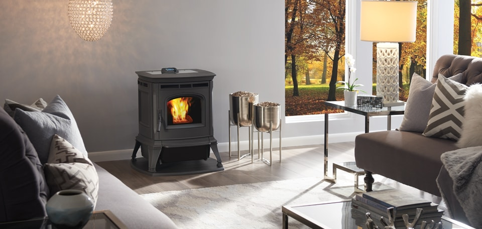 Absolute43 Pellet Stove shown in Matte Black with optional Harman Protect Hearth Pad