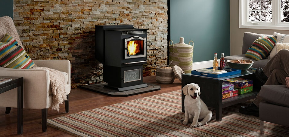P61 Pellet Stove shown with optional Modern brushed stainless trim, deer slate and log set